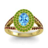 Ornate Oval Halo Dhala Swiss Blue Topaz Ring with Peridot and Garnet in 14k Yellow Gold