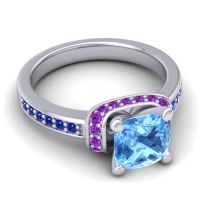 Halo Cushion Aksika Swiss Blue Topaz Ring with Amethyst and Blue Sapphire in 18k White Gold