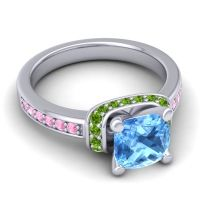 Halo Cushion Aksika Swiss Blue Topaz Ring with Peridot and Pink Tourmaline in 14k White Gold
