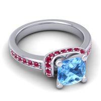 Halo Cushion Aksika Swiss Blue Topaz Ring with Ruby in Palladium