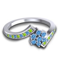 Simple Floral Pave Utpala Swiss Blue Topaz Ring with Peridot in 18k White Gold